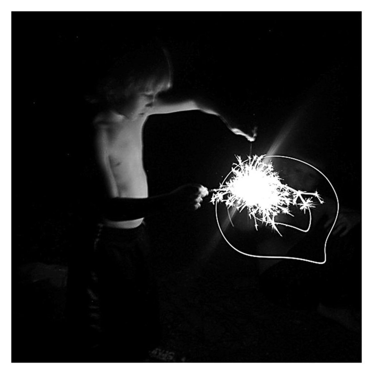 FIRECRACKER When I took this photograph, I knew my light settings were off and that the lighting was impossible. I kept shooting and later discovered this image. The light opposed to the fading body can be symbolic of childhood and the bright future.