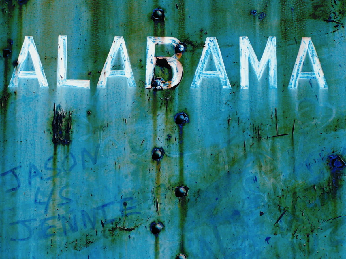 """""""Alabama."""" I cannot control my photographic impulses when industrial locations are involved. This old train yard in Calera, Alabama, is a gold mine of imagery just waiting for a camera. This is a photo of a train car, complete with graffiti."""