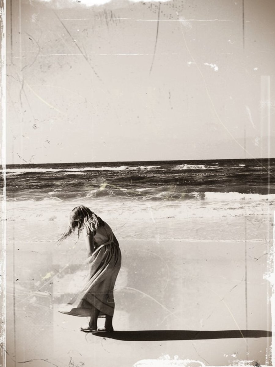 """""""Daughter."""" This image of my daughter on the beach was changed into a sepia image. The effect was startling. The original image is bright and colorful, while this one looks nostalgic. Experimentation with imagery is always a welcome exercise."""