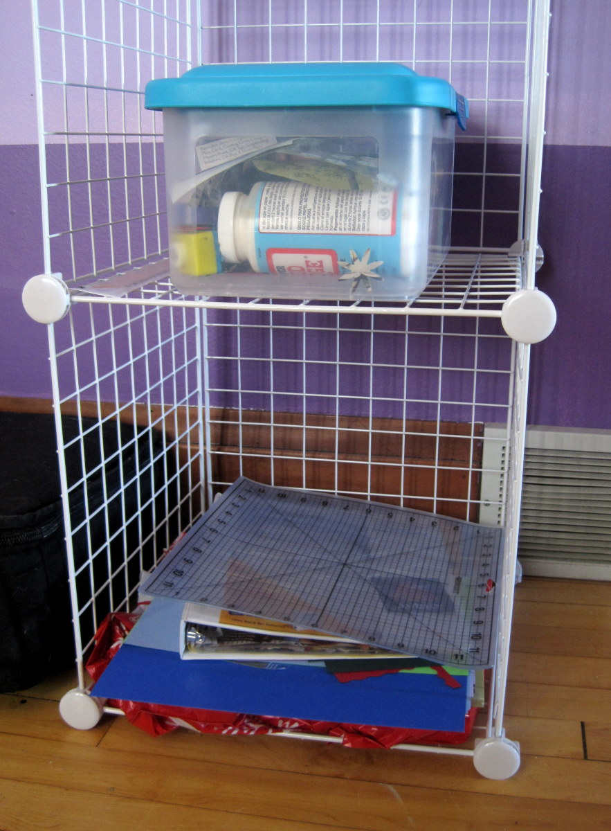 I keep a lot of my scrap book and card making supplies in a container and put larger paper and supplies on another shelf.
