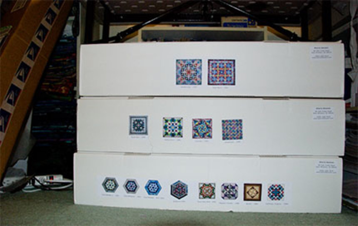 Consider boxes or other larger containers for storing sizable items, such as quilts.  Make sure that they are cushioned appropriately.