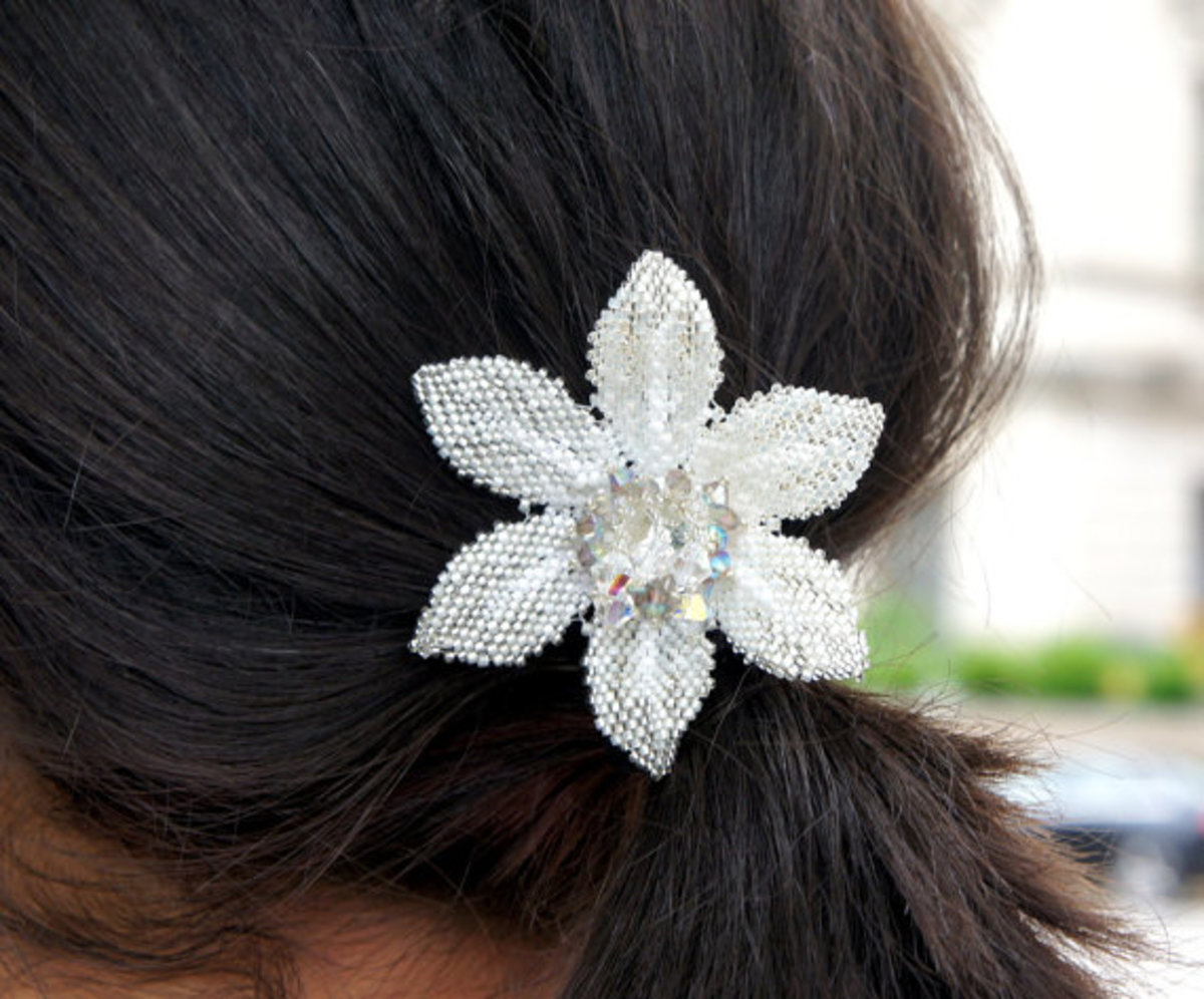 Swarovski components accent this flower clip.