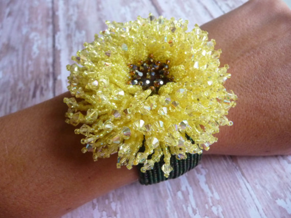 This flower creates a stunning focal for this beaded cuff.