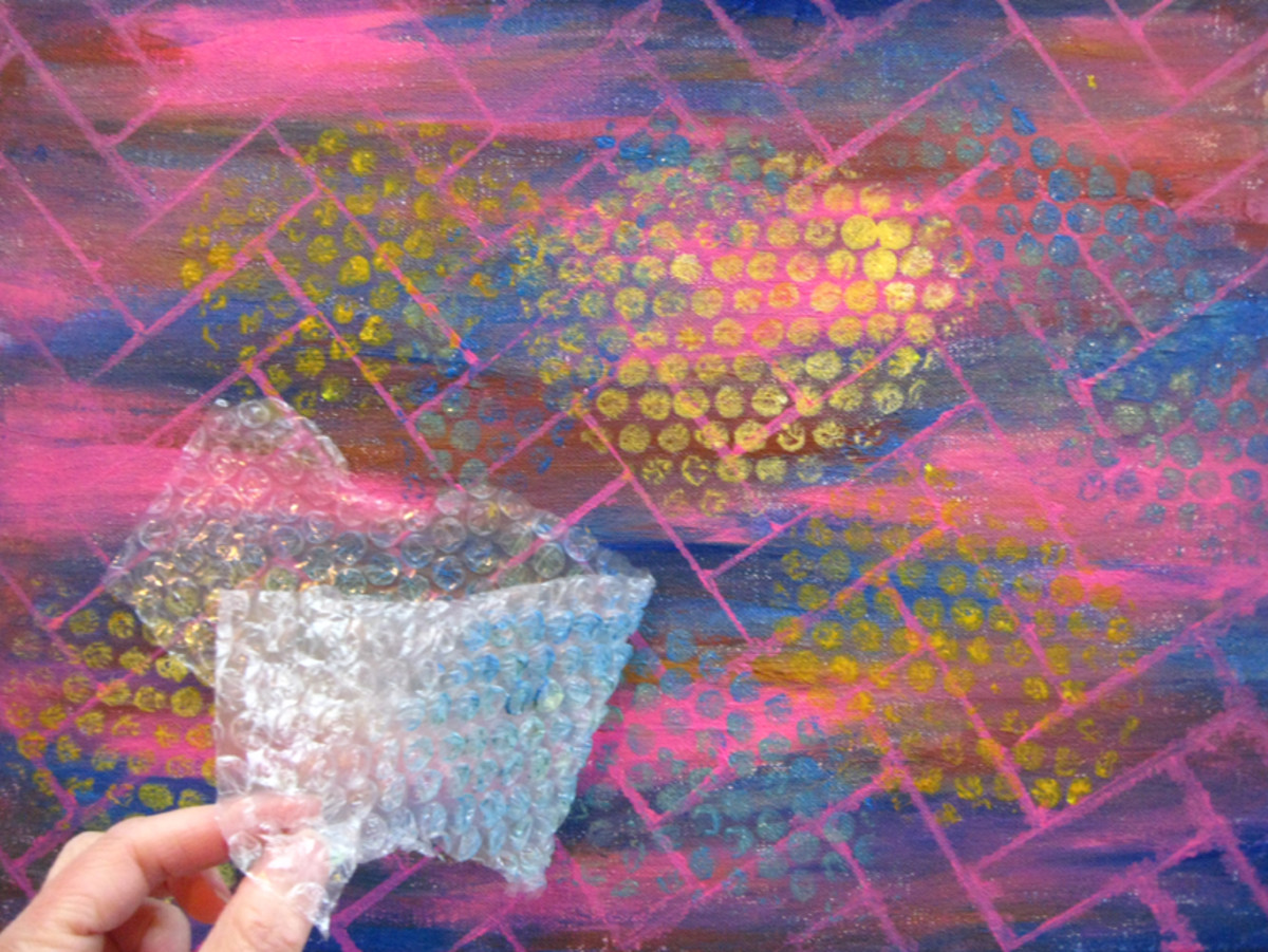 Using bubble-wrap to add texture to an abstract painting. Click the source link to see the final result of using this painting as background for a model portrait.