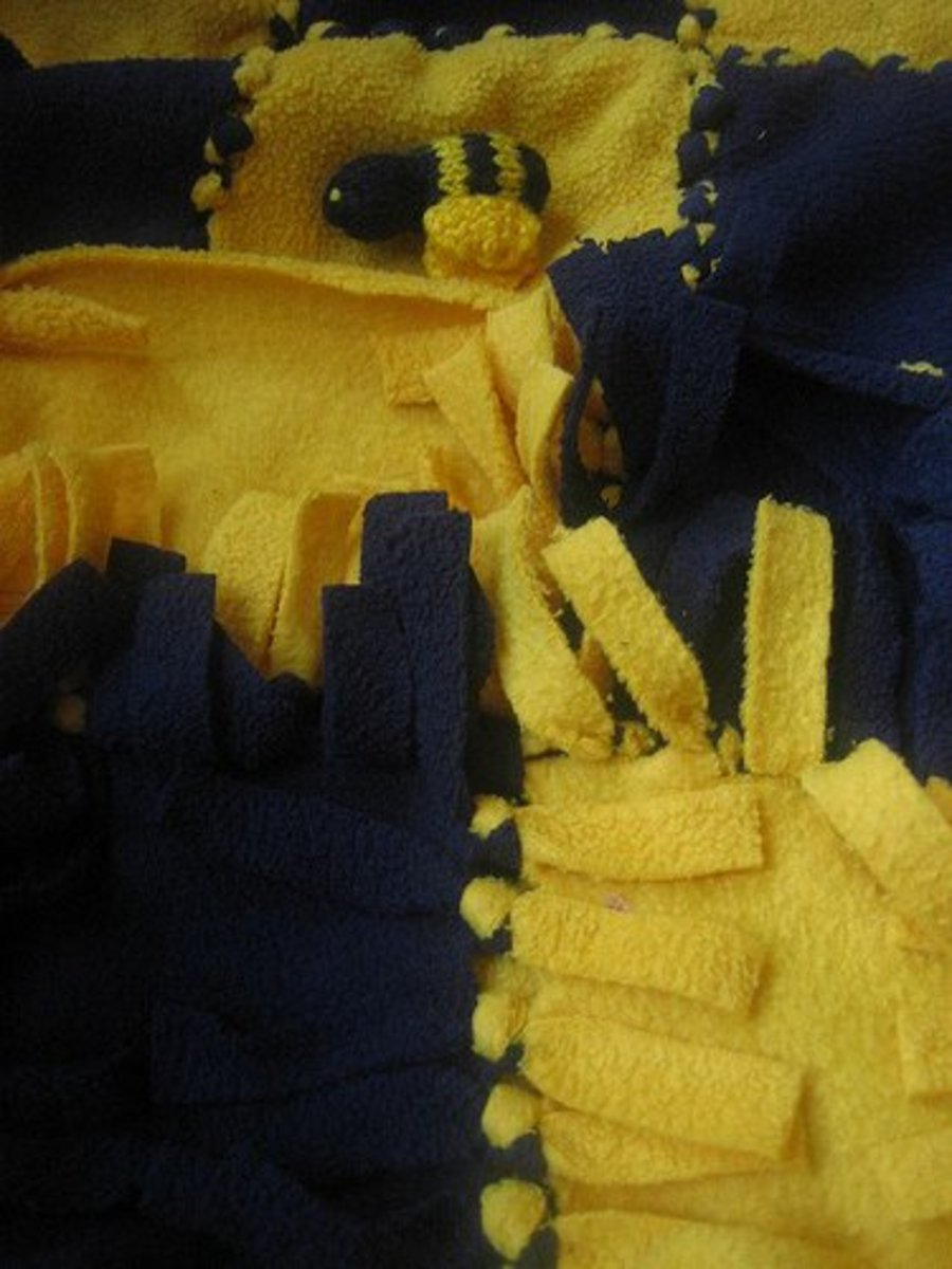 A detailed close-up of the tie blanket knots