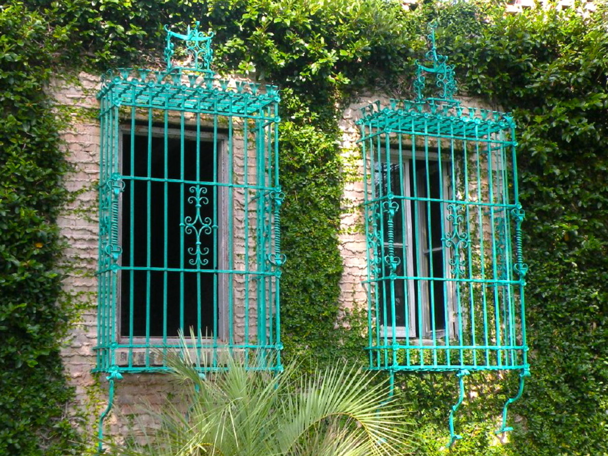 Beautiful wrought iron window grates were designed by Anna Hyatt Huntington.