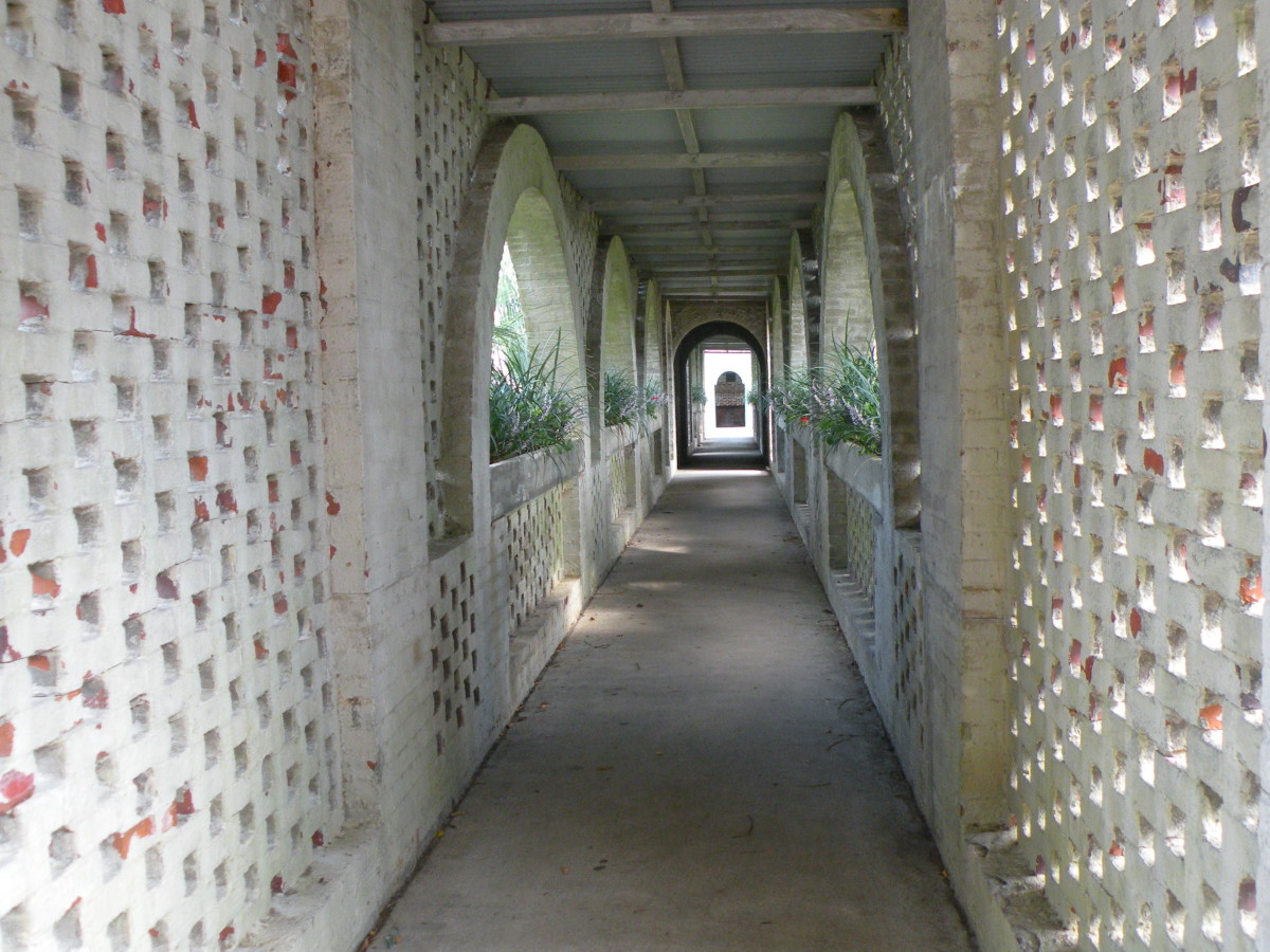 The covered walkway through the courtyard leads from the front entry courtyard to the front door.