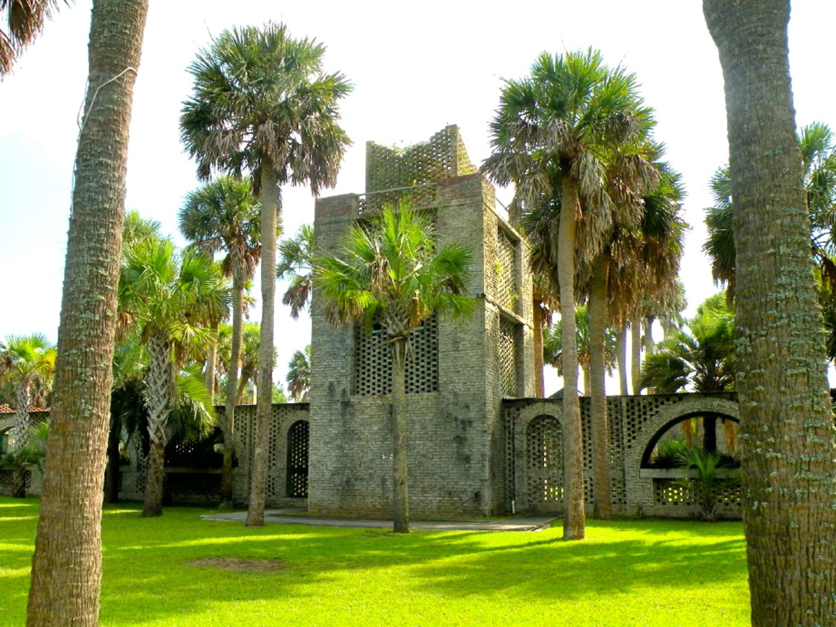 "The 40-foot tower, used for water storage, stands in the middle of the walkway that bisects the courtyard. ""Atalaya"" is a Spanish word meaning watch tower."