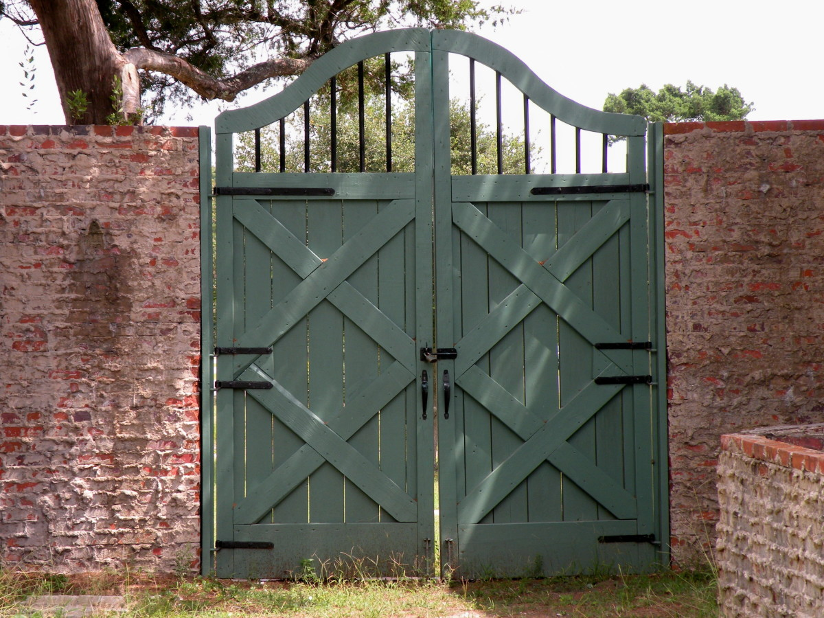 Gates and doors were all designed by Anna. This one is in the entry courtyard and opens out onto grassy lawns.