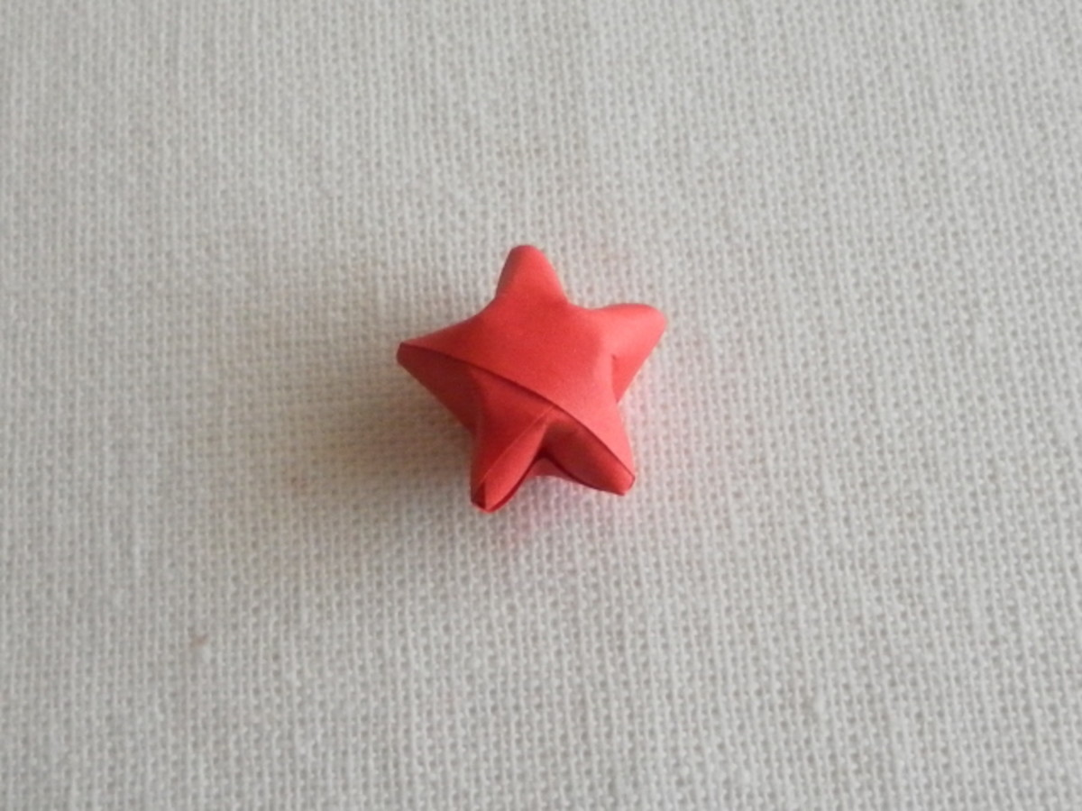 Push all the sides in to form a lucky star.