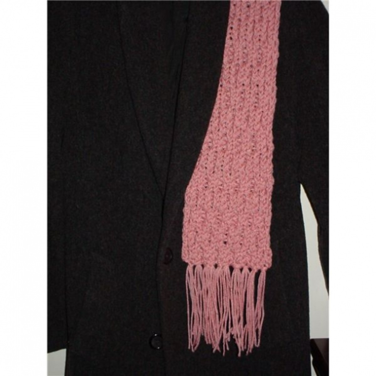 Pink honeycomb scarf knitted on the pink Knifty Knitter loom.