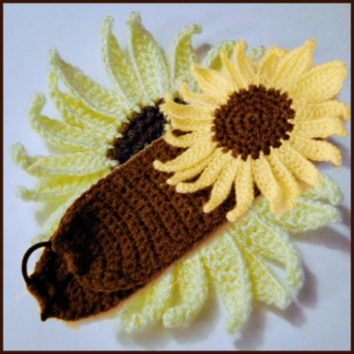 Elasticated sunflower headband to brighten up those cold days.