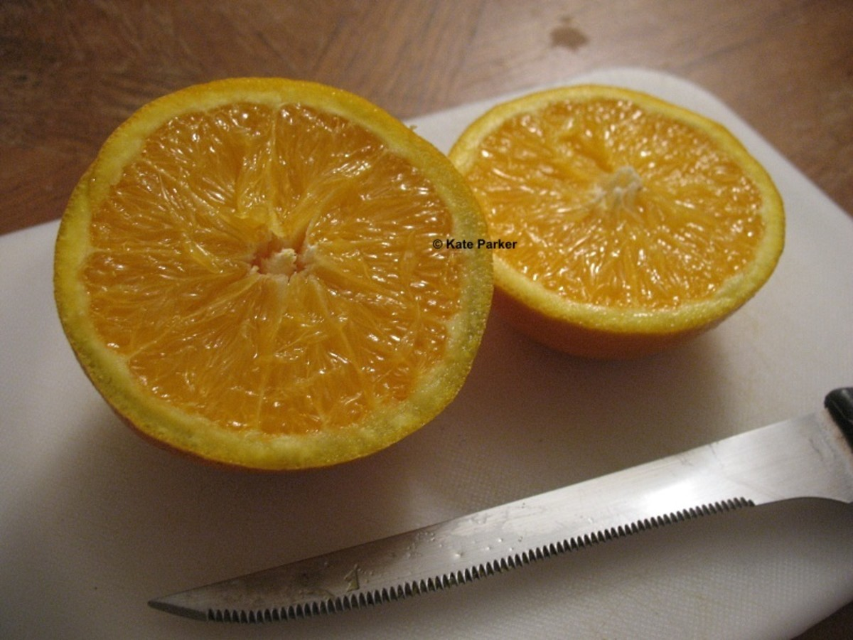 Cut the orange (citrus) in half