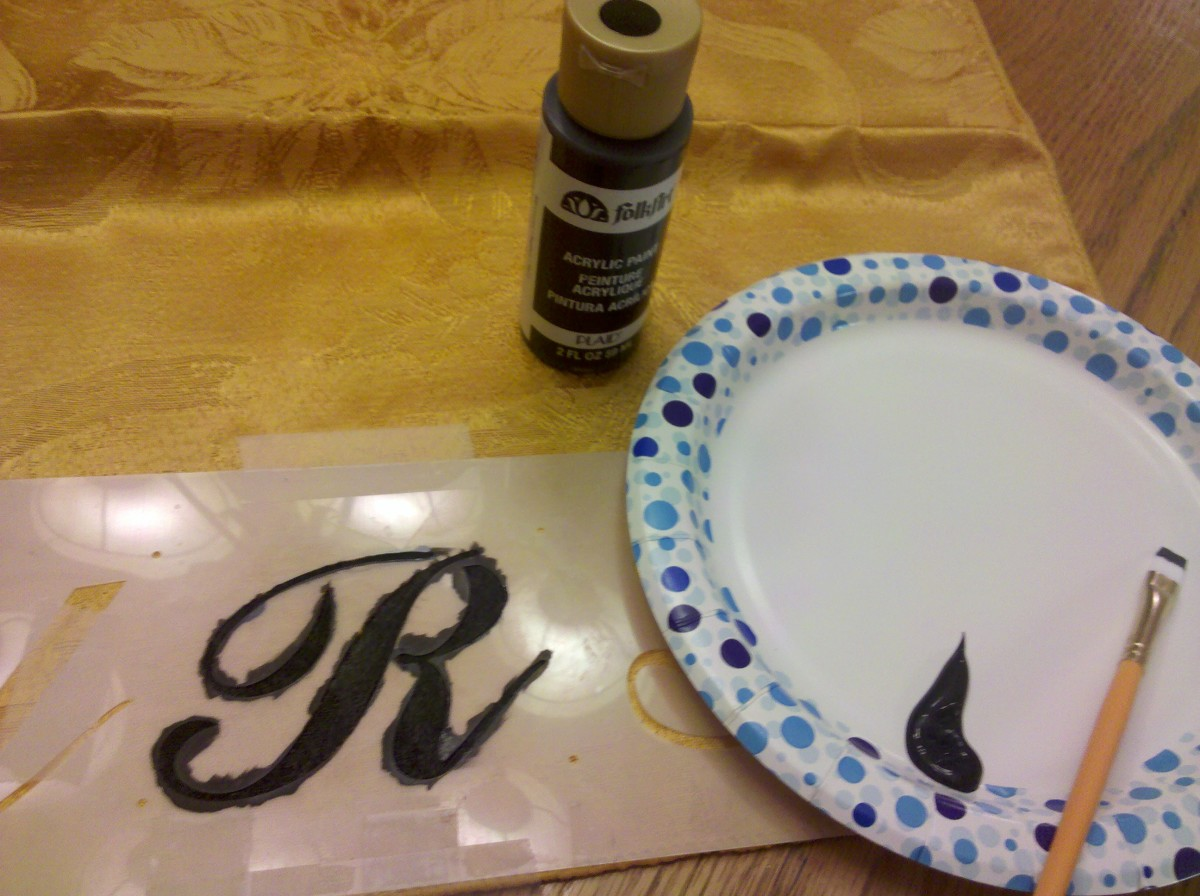 Paint stencil with desired color of fabric paint.