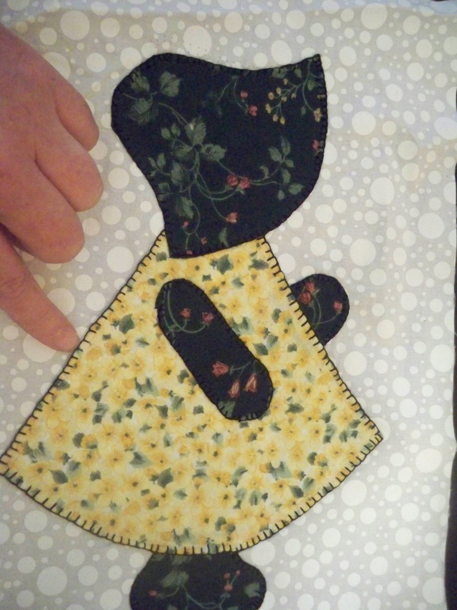You can see I have finished the applique on this block and my stitches are neat and uniform for the most part.
