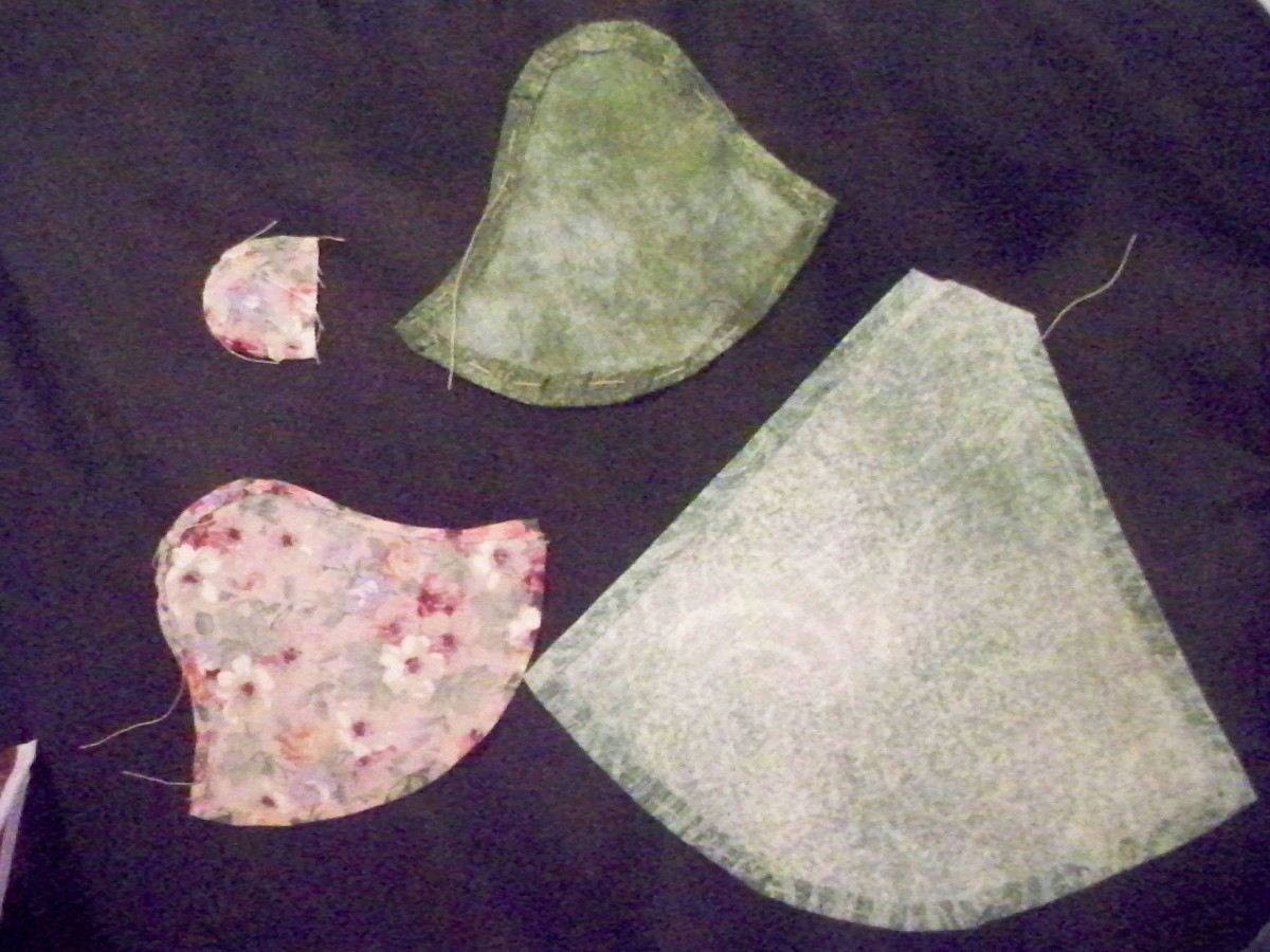 These pieces have had the freezer paper removed.  You can see that the seem is still there as well as your basting stitches.