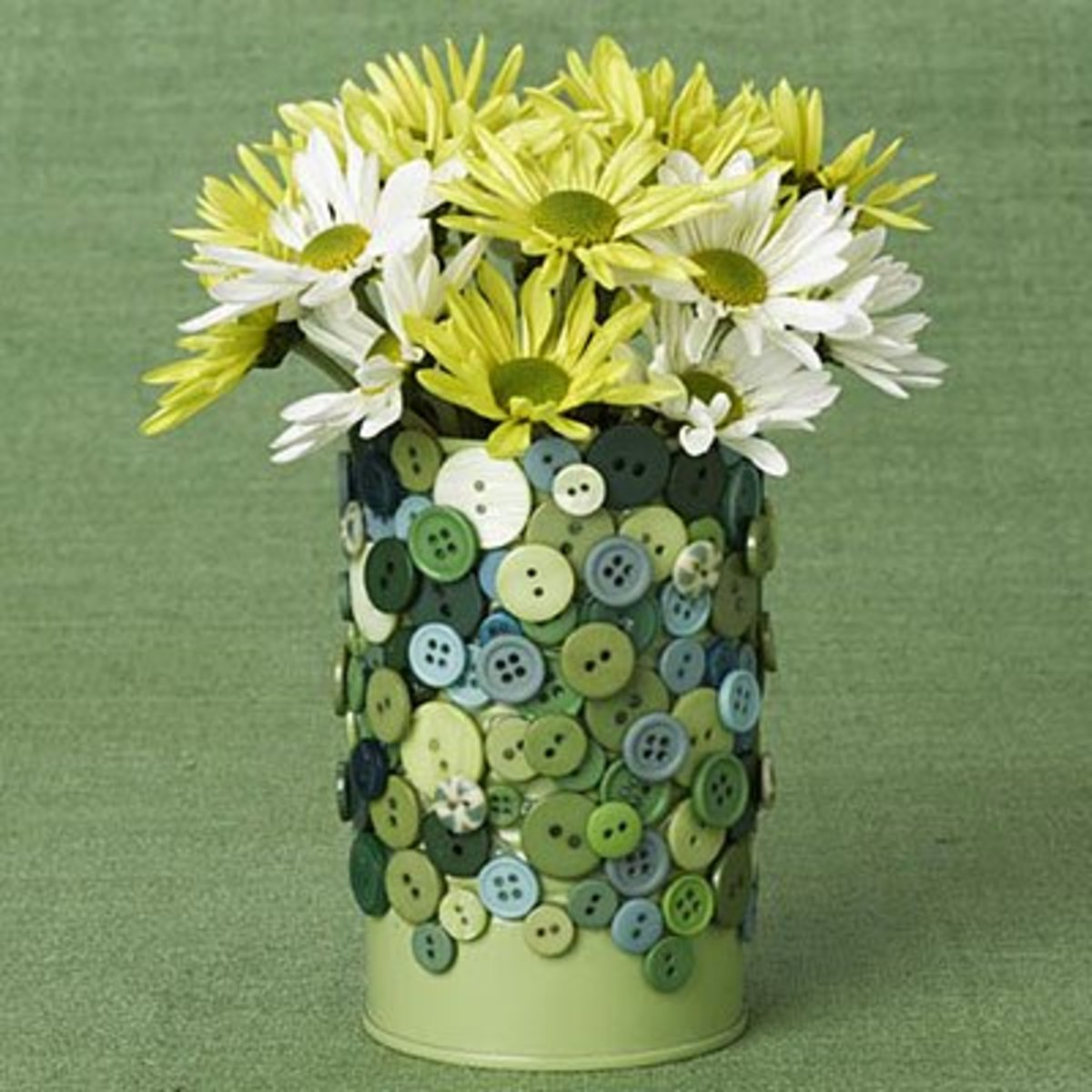 tin can covered with buttons