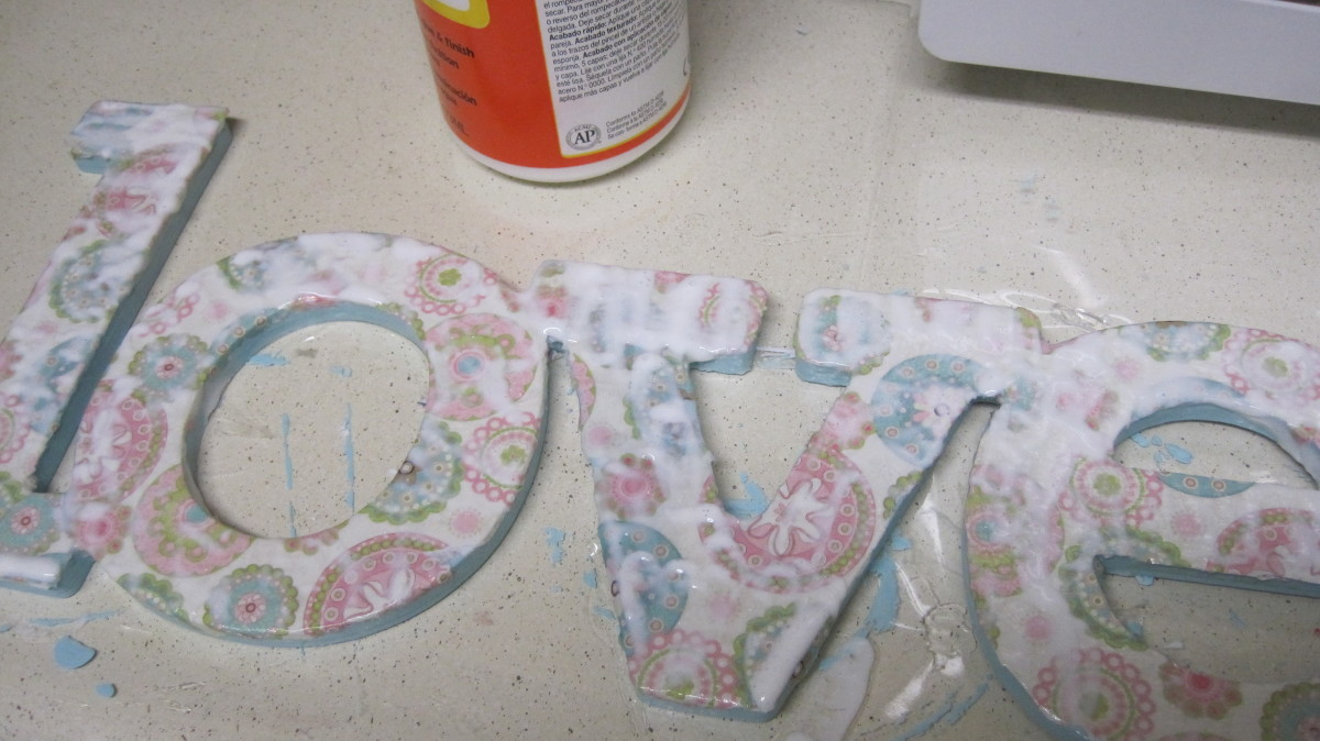When the letters are covered, add Modge Pod or Decoupage sealant to the entire word or letter.