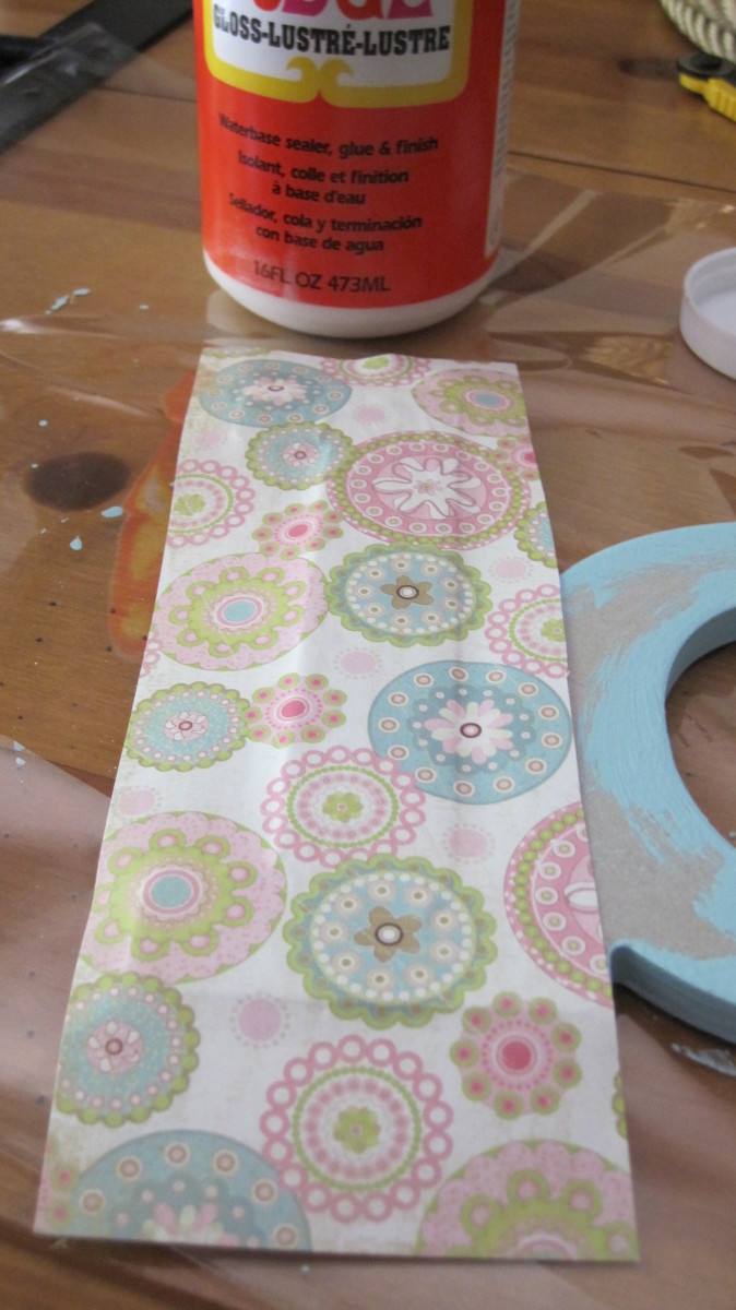 Apply a medium layer of Mod Podge and cover the letter with your selected paper