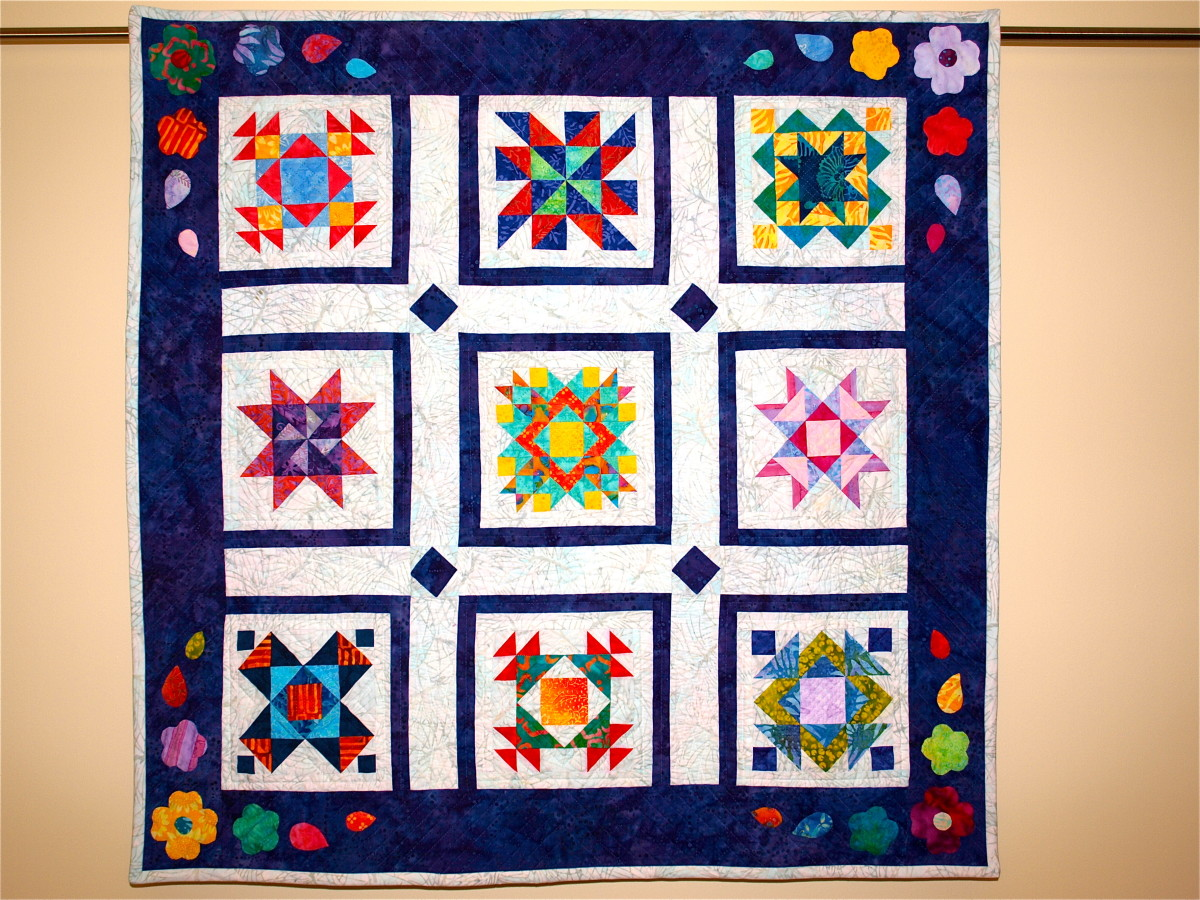 Hand Quilting vs. Machine Quilting - Sampler Quilt using traditional blocks with vibrant modern fabrics.
