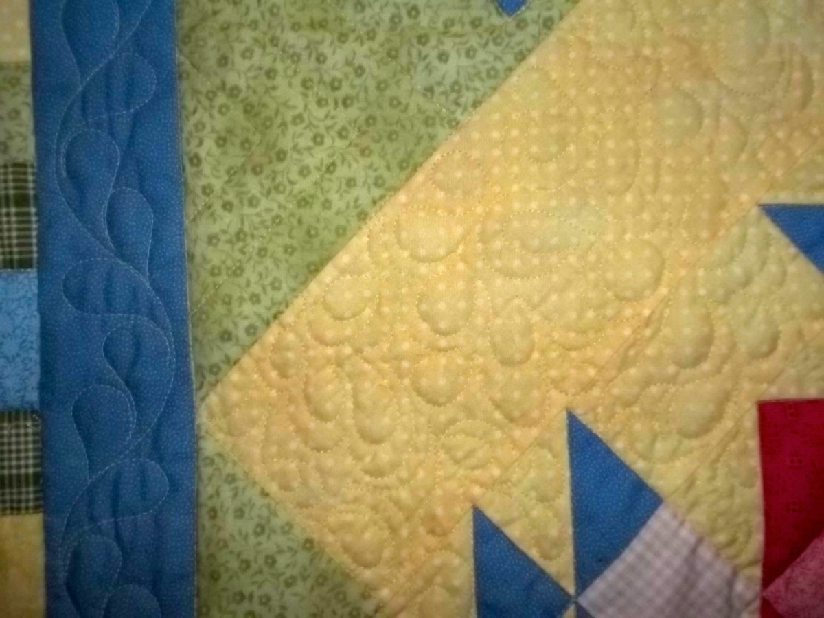 Close up detail of a professionally machine quilted quilt.