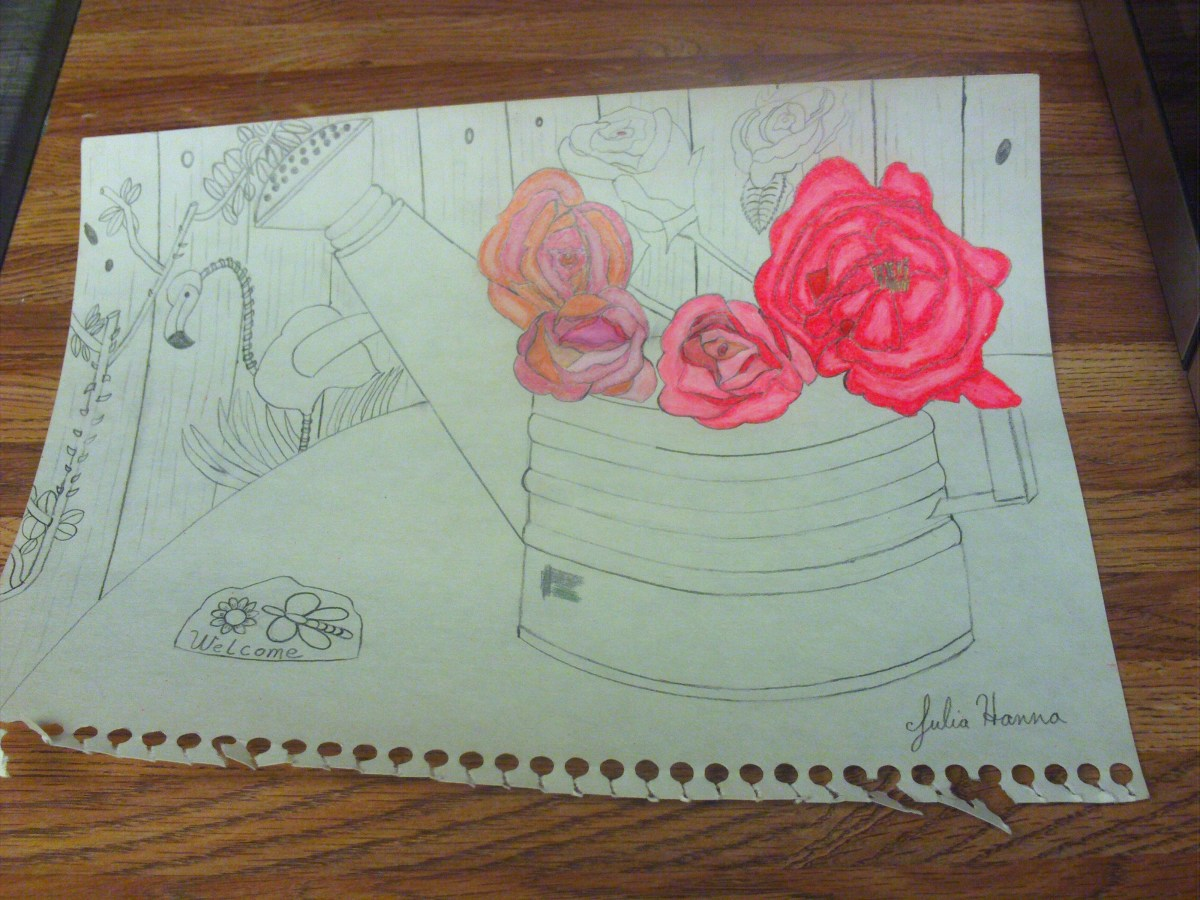 I am coloring in the roses with several different shades of pink colored pencils.