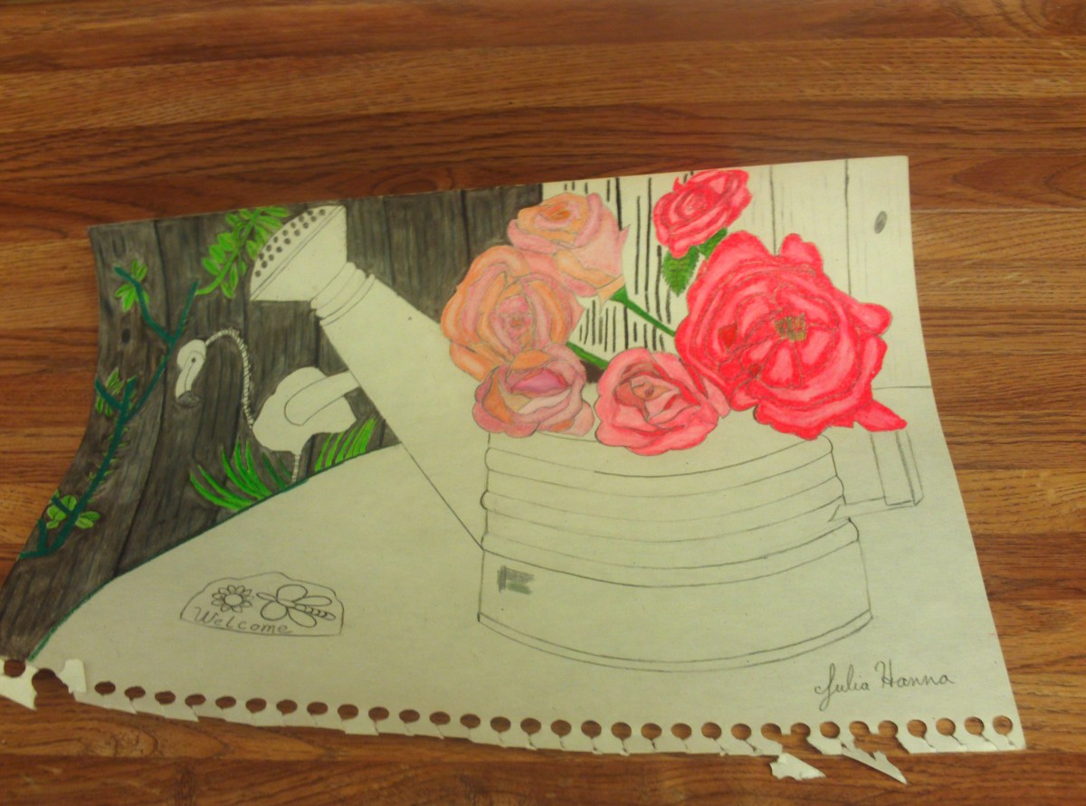 I am using the black colored pencil to undercolor the darker part of the fence.