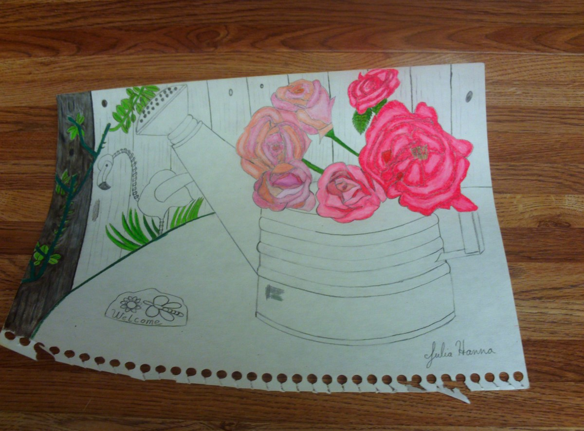Here I am beginning to color in the first board of the fence behind the roses and flamingo decoration.