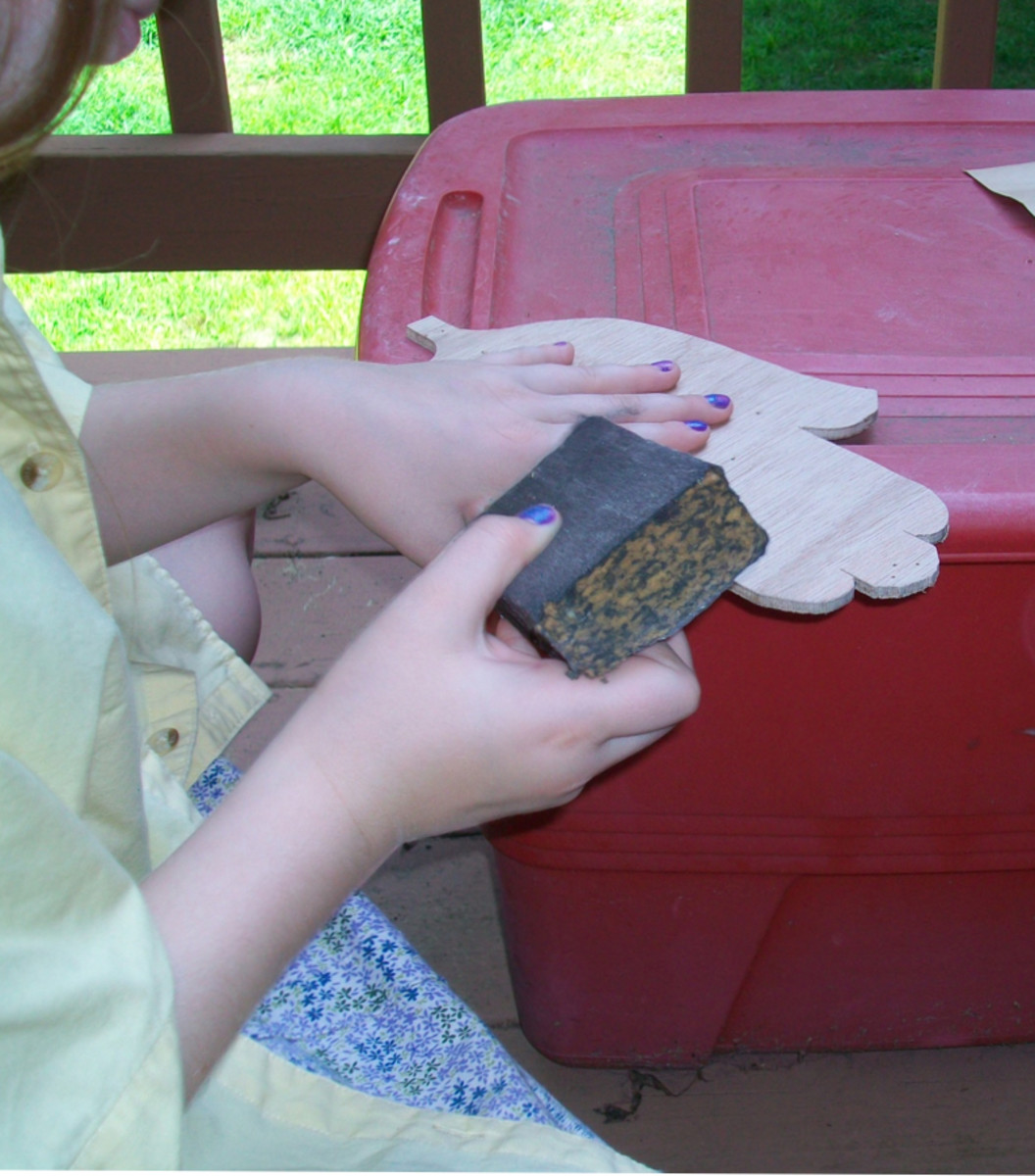 Have your kids use a sanding block to smooth out the rough edges.
