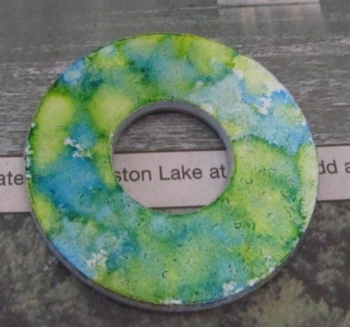 This is the finished metal washer after applying alcohol ink.