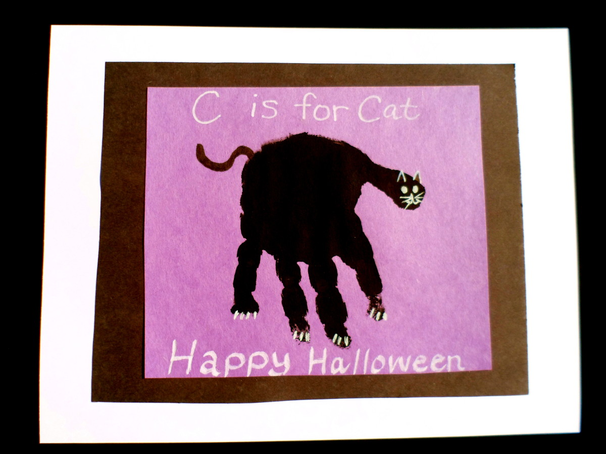 A black handprint makes a cute halloween cat.