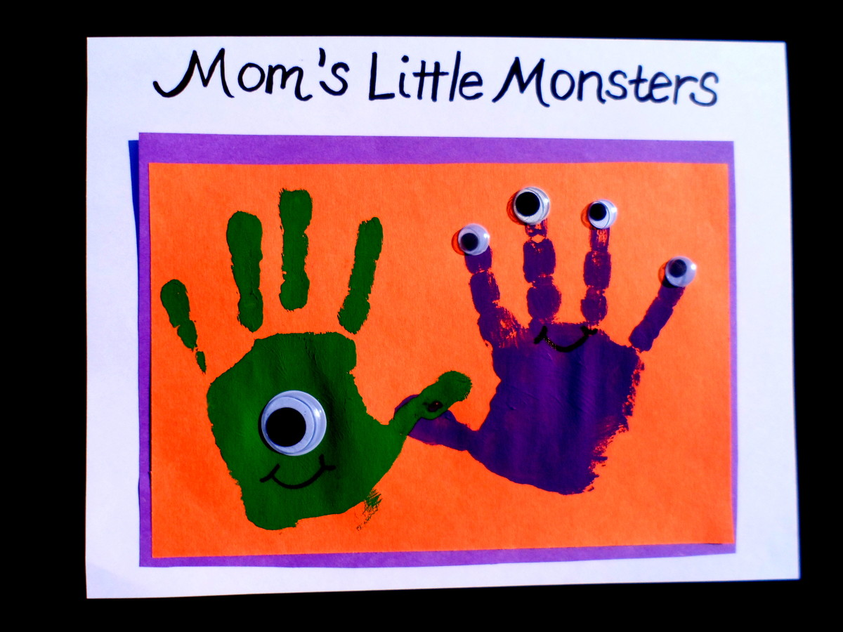 Green and purple painted hands make out of this world monsters and aliens.