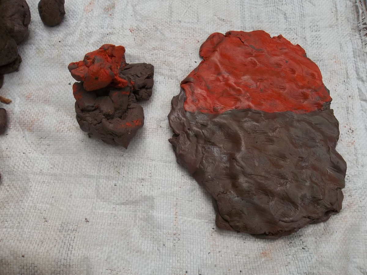 Plasticine with  petroleum jelly between the layers.