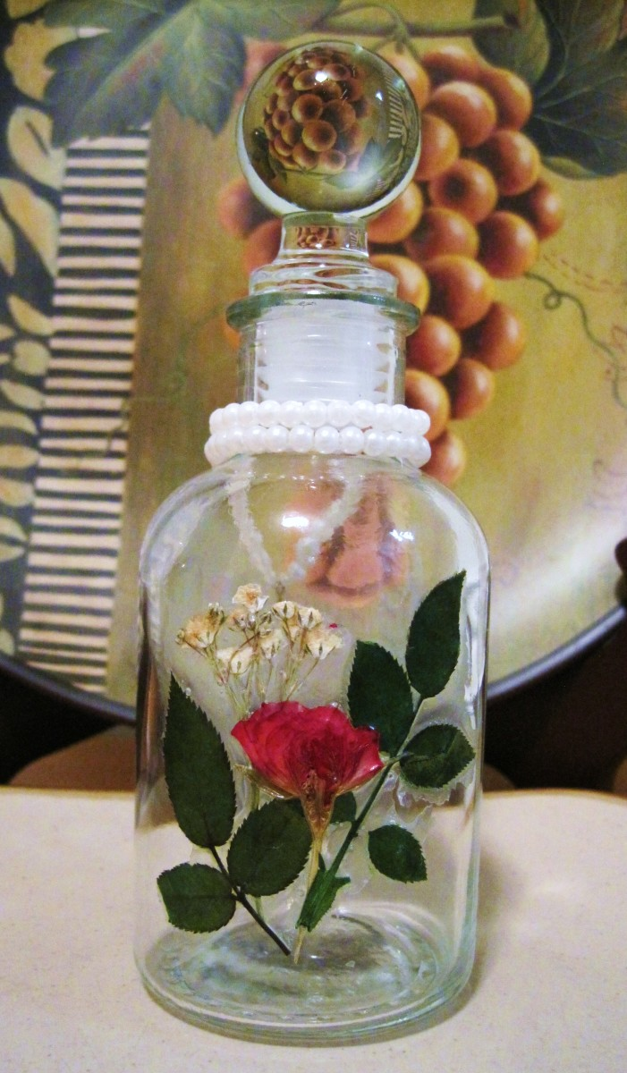 A bottle decorated with pressed roses