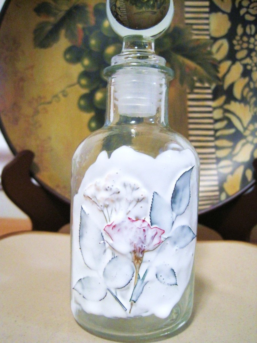 Set the flowers in the wet glue. Cover with another coat of Mod Podge and allow the jar to dry.