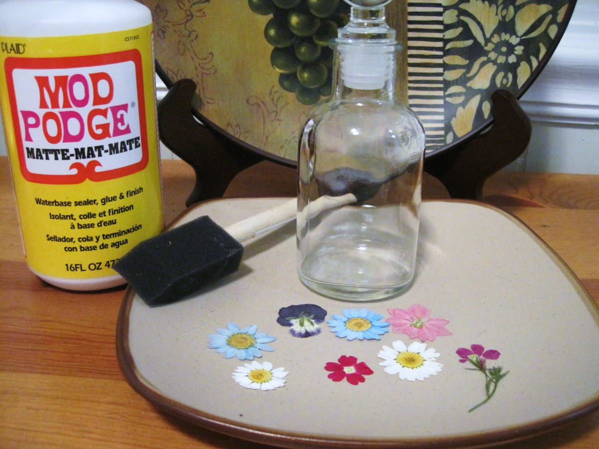 Supplies needed to make a pressed flower jar.
