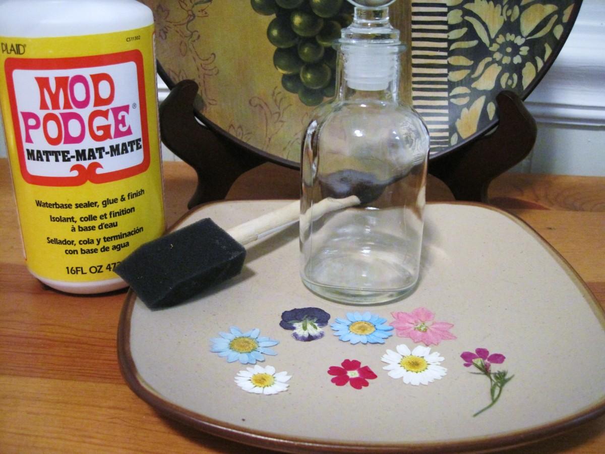 Supplies needed to make a pressed flower jar.