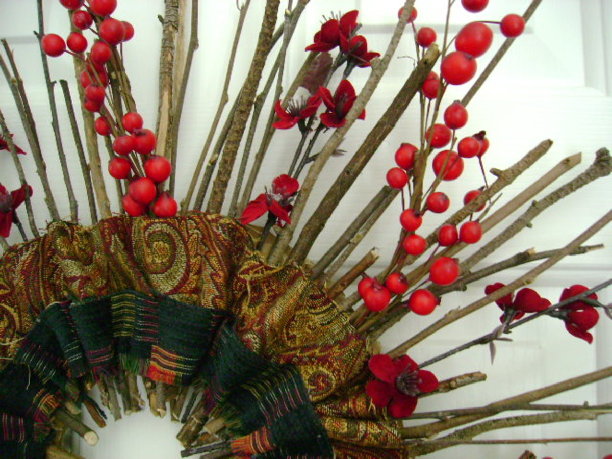 sticks and fabric are used to create a handmade holiday wreath  (c) purl3agony 2012