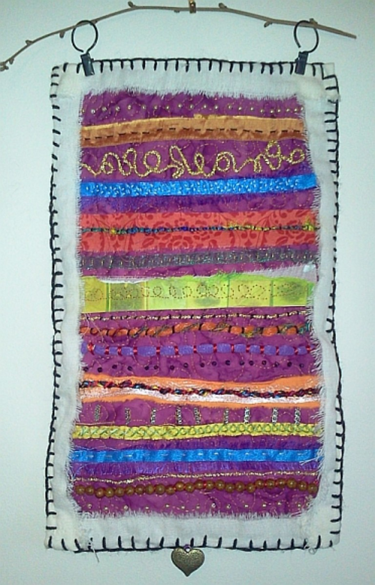 Wall hanging made from scrap batik, fabric strips, produce bags and paper.
