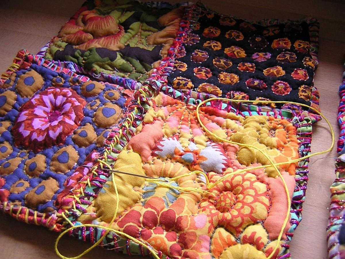 Assembling fabric pillows.