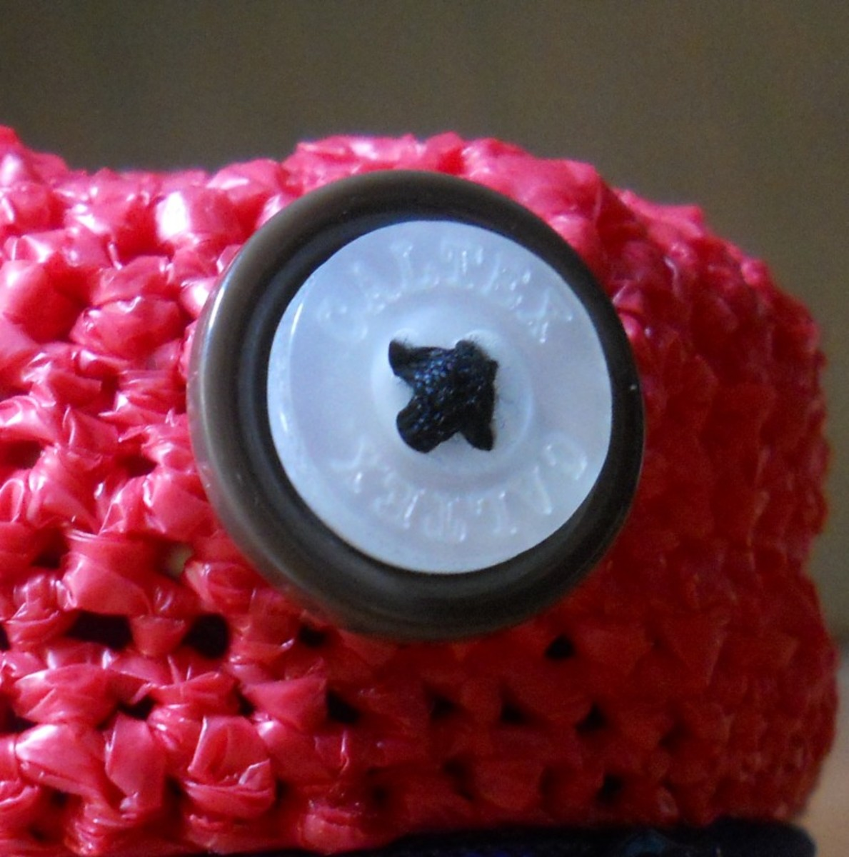 Molih's eyes consist of two buttons sewed together.