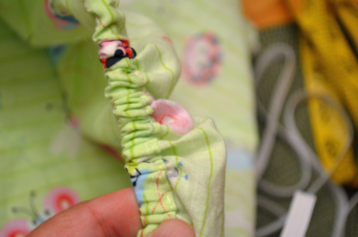 Pull the elastic all the way through the sleeve then sew the opening shut and you're done.