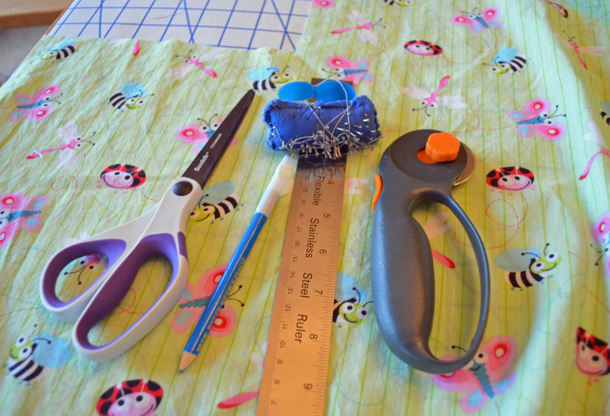 Some simple tools, 2 yards of fabric and a few yards of elastic--all you need to make your own crib sheets.