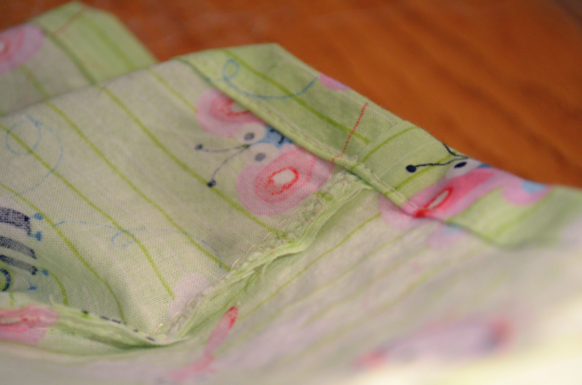 Sew sleeve into hem of crib sheet