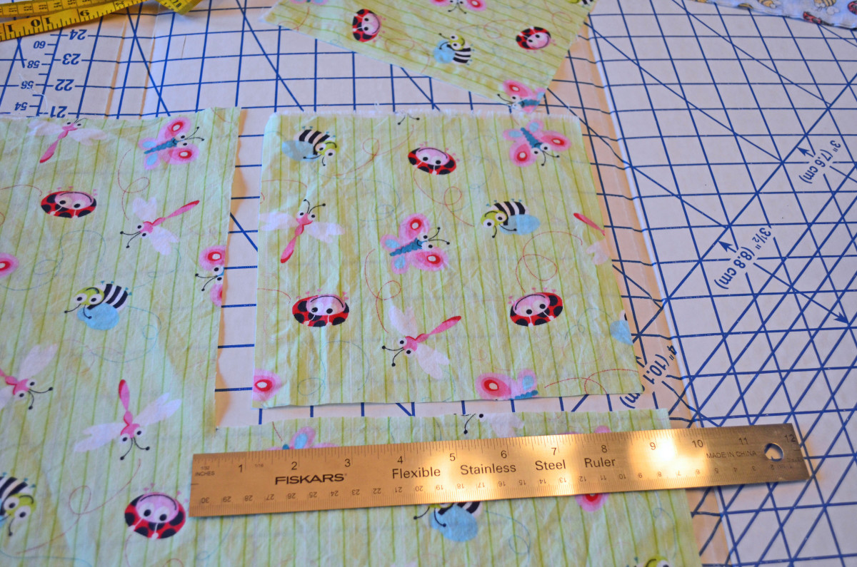 """Start by cutting 8"""" or 9"""" square from the four corners of the fabric."""