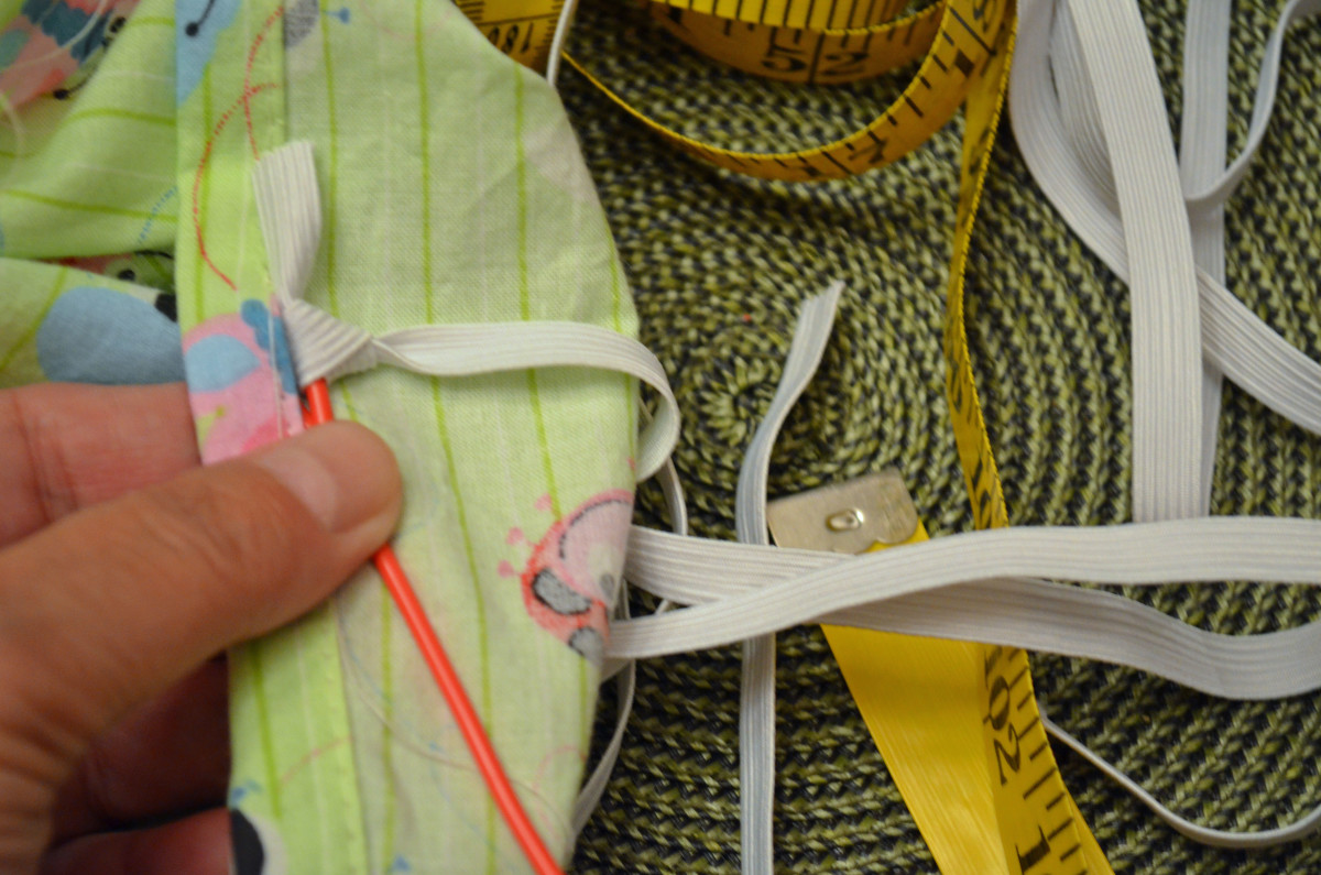 Thread elastic through the sleeve with either a safety pin or a plastic threader.