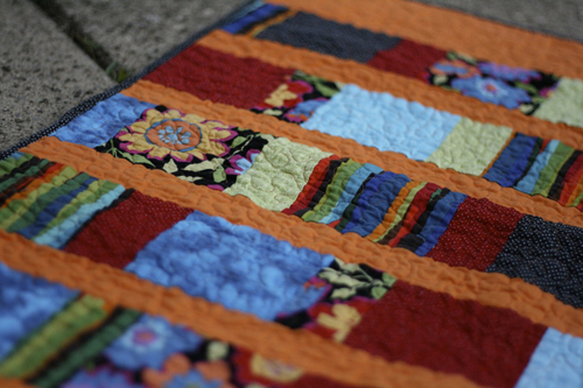 This quilt uses different lengths of rectangles and is quick and easy for a beginner.