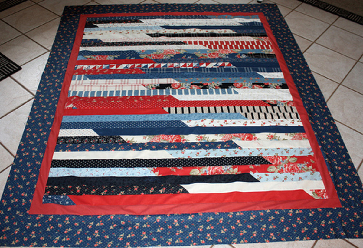 This quilt is made of jelly roll strips, so you do not have to do much cutting, and is easy to piece together quickly.