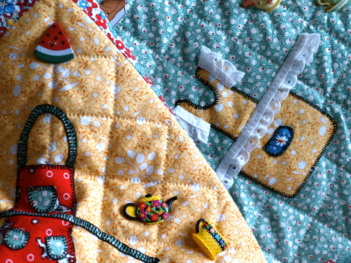Buttons, lace and decorative hand stitching embellishments add whimsy and character to a quilt, and help tell it's story.