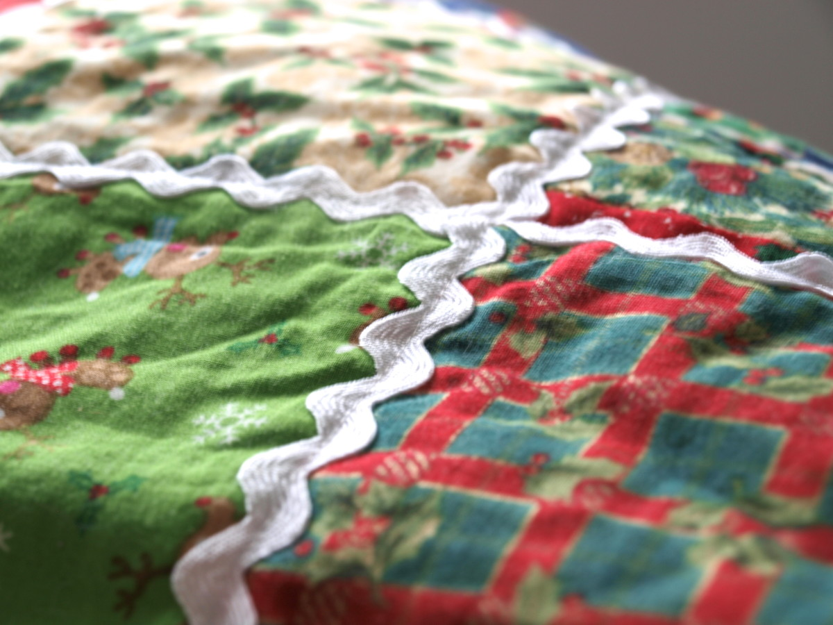 Ric Rac adds a whimsical touch to this Christmas throw quilt.  It was added by machine as part of the quilting process and can be washed.